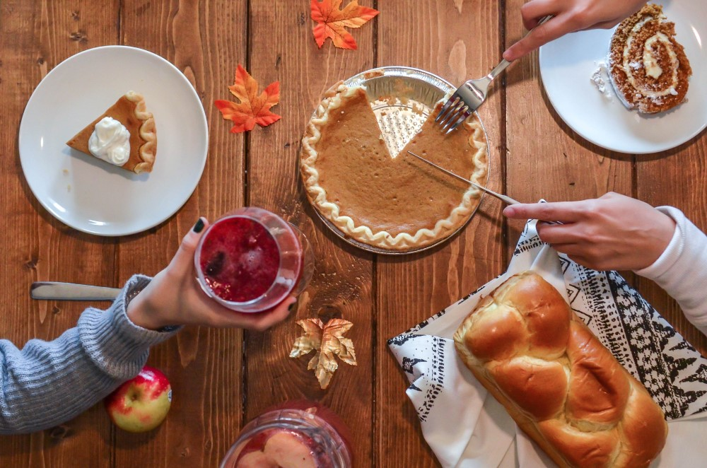 Person serving Thanksgiving pie